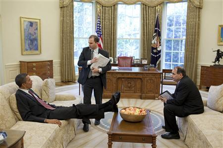 White House handout shows U.S. President Obama talks with Deputy National Security Advisor for Strategic Communication Rhodes and Senior Advisor Axelrod in the Oval Office